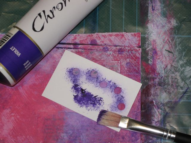 Using a dry brush apply purple paint over stencil