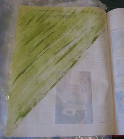 Adding green paint to mixed media art journal