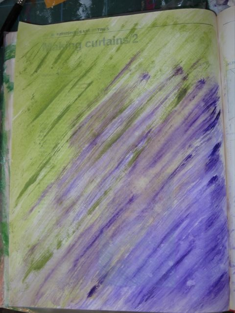 Adding purple paint to art journal