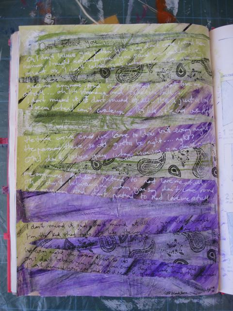 Writing added with gel pens onto art journal