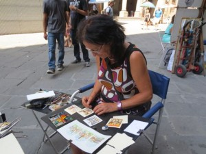 Street artists in Florence, outside the Uffizi Gallery