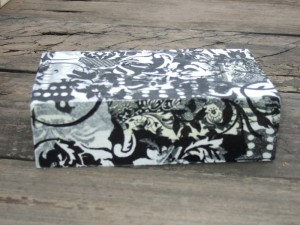 base of gift box covered with black and white napkins