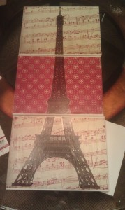 Scrapbooking papers, canvas and an Eiffel tower decal were used to create this amazing piece.