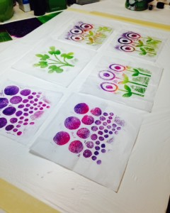 Layering patterns and designs with transparent stamped collage layers.