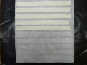 Put strips of tape on the baking paper