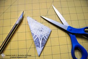 Draw a design onto the triangle.