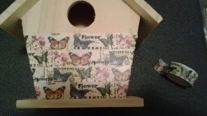 adding washi tape to the birdhouse