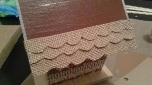 adding scalloped burlap strips to roof