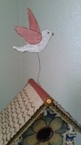glue the wire on the bird and birdhouse