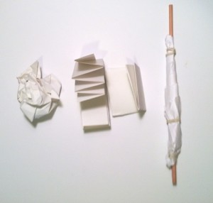 Paper in different shapes: folded, rolled and crumpled.