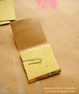 Add sketchbook paper. Use paper clip to hold paper in place.