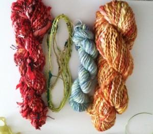 Several kinds of textured, embellished yarns