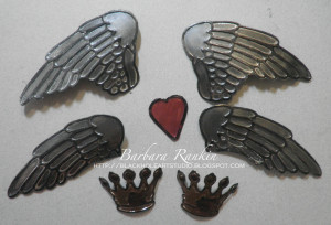 photo of painted metal foil covered cardstock and diecuts