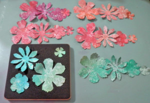 die cut flowers from each colored section of paper/aluminum foil sheet