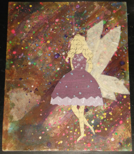 The fairy & her wings have been attached and the painting of the waistband and hairband are done